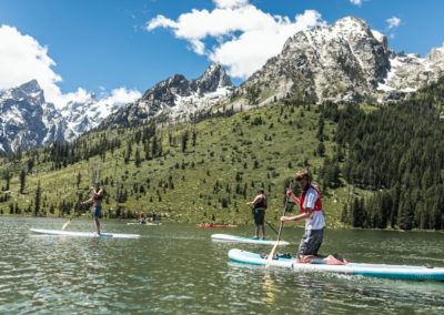Christopher on SUP under Tetons
